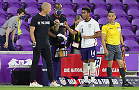ORLANDO CITY, FL - JANUARY 31: Gregg Berhalter head coach of the United States chats with Jonathan Lewis #14 during a game between Trinidad and Tobago and USMNT at Exploria stadium on January 31, 2021 in Orlando City, Florida.