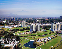 aerial photograph the Interlomas Golf Course in Mexico City with Iztaccihuatl and Popcatepetl volcanoes in the background | fotografía aérea del campo de golf Interlomas en la Ciudad de México con los volcanes Iztaccíhuatl y Popcatepetl al fondo
