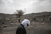 Thursday 09 July, 2015: A displaced man from the heavy fighting and bombardments in Haradh bordertown is seen walking in Darawan, a temporary settlement in the outskirts of Sana'a, the capital city of Yemen. The man lost his wife and three daughters during the airstrikes by the Saudi-led coalition. (Photo/Narciso Contreras)