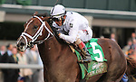 October 04, 2014: Carpe Diem and jockey John Velazquez win the 101st running of The Claiborne Breeders' Futurity Grade 1 $500,000 at Keeneland for owner Winstar Farm and Stonestreet Stables and trainer Todd Pletcher .  Candice Chavez/ESW/CSM