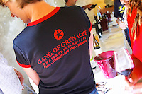 """A wine taster with a black t-shirt tshirt saying """"The Gang of Grenache"""" advertising a group of Chateauneuf-du-Pape growers. Rhone. Tasting wine. Ice bucket. France Europe."""