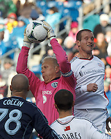 Sporting Kansas City goalkeeper Jimmy Nielsen (1) snares a corner kick.  In a Major League Soccer (MLS) match, Sporting Kansas City (blue) tied the New England Revolution (white), 0-0, at Gillette Stadium on March 23, 2013.
