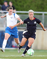 Lori Lindsey #6 of the Washington Freedom pulls away from Kelly Schmedes #3 of the Boston Breakers during a WPS match at the Maryland Soccerplex, in Boyd's, Maryland, on April 18 2009. Breakers won the match 3-1.