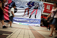 CHINA. English advertising in central Beijing. The rise in use of English in China is evident on the streets of Beijing where store-fronts, billboards and clothes all sport English words and phrases. 2009