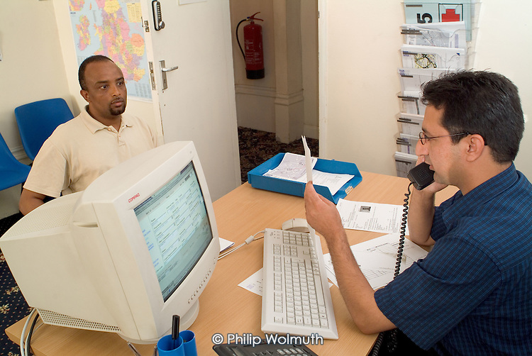 A newly arrived asylum-seeker from Ethiopia is given advice at a Problem Clinic in a Dover hotel used by Migrant Helpline to house refugees awaiting decisions on their asylum applications..