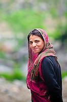 A young, nomadic Bakarwal woman suppresses a smile, Naranag, Kashmir, India.