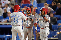 Clearwater Threshers Emmanuel Marrero is congratulated by Drew Stankiewicz (center) and Grenny Cumana (right) after hitting a home run in the top of the sixth inning during a game against the Dunedin Blue Jays on April 8, 2017 at Florida Auto Exchange Stadium in Dunedin, Florida.  Dunedin defeated Clearwater 12-6.  (Mike Janes/Four Seam Images)