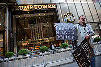 """NEW YORK, NY - JULY 9: A man with placards isupporting Trump yells next to the """"Black Lives Matter"""" mural in front of the Trump Tower in New York, NY on July 9, 2020. Bill de Blasio, Mayor of New York and founders of National Action Network Inc. (NAN) paint a """"Black Lives Matter"""" mural along Fifth Avenue in front of the Trump Tower in New York. President Donald Trump criticized the mayor's plan to paint a street mural in front of Trump Tower. (Photo by Pablo Monsalve / VIEWpress via Getty Images)"""