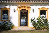 Private home in Parati Brazil. Colonial Portugese architecture with yellow trimming around the door and windows.