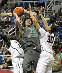 Green Valley's Ikaika Pladera shoots against Hug's Norris Dupree, left, and Felix Cox during a semi-final game in the NIAA 4A State Basketball Championships between Hug and Green Valley high schools at Lawlor Events Center in Reno, Nev, on Thursday, Feb. 23, 2012. Hug won 70-68..Photo by Cathleen Allison