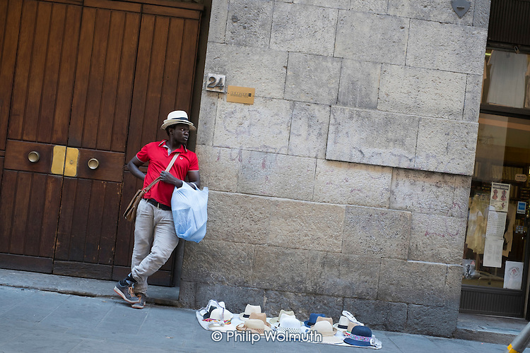 Unlicensed African street seller, Florence, Italy.