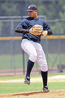 Erick Tapia (74) Pitcher for the GCL Yankees delivers a pitch during a game on June 23, 2010 against the GCL Tigers at the Yankees Training Complex in Tampa, The GCL Yankees are the Gulf Coast Rookie League affiliate of the New York Yankees. Photo By Mark LoMoglio/Four Seam Images