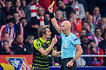 Fabio Coentrao of Sporting CP (L) given a yellow card by referee Sergei Karasev (R) during the UEFA Europa League quarter final leg one match between Atletico Madrid and Sporting CP at Wanda Metropolitano on April 5, 2018 in Madrid, Spain. Photo by Diego Souto / Power Sport Images