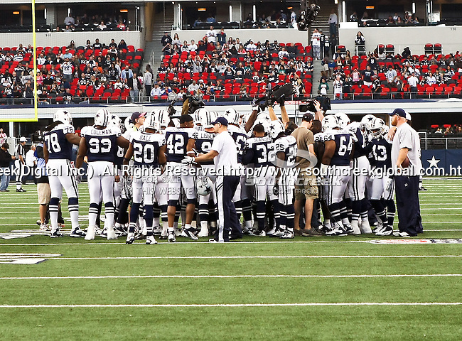 Dallas Cowboys team gets ready for action during the Thanksgiving Day game between the Miami Dolphins and the Dallas Cowboys at the Cowboys Stadium in Arlington, Texas. Dallas defeats Miami 20 to 19...