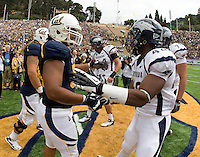 California captain Aaron Tipoti shakes hands with Nevada DeAndre Boughton during coin toss before the game at Memorial Stadium in Berkeley, California on September 1st, 2012.  Nevada Wolf Pack defeated California, 31-24.