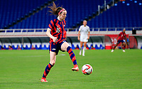 SAITAMA, JAPAN - JULY 24: Rose Lavelle #16 of the United States passes off the ball during a game between New Zealand and USWNT at Saitama Stadium on July 24, 2021 in Saitama, Japan.
