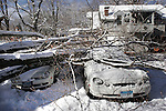 WINSTED, CT04 January 2006-010406TK08 A large tree collapsed from the weight of the snow on 53 Park Place in Winsted resulting in significant damage on parked cars beneath the tree.   Tom Kabelka / Republican-American