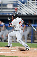 Connecticut Tigers shortstop Domingo Leyba (7) at bat during the second game of a doubleheader against the Batavia Muckdogs on July 20, 2014 at Dwyer Stadium in Batavia, New York.  Connecticut defeated Batavia 2-0.  (Mike Janes/Four Seam Images)