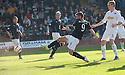 Dundee's Peter MacDonald scores their first goal.