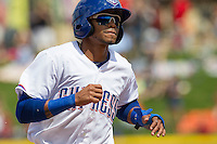 Round Rock Express outfielder Engel Beltre #7 rounds third base against the New Orleans Zephyrs in the Pacific Coast League baseball game on April 21, 2013 at the Dell Diamond in Round Rock, Texas. Round Rock defeated New Orleans 7-1. (Andrew Woolley/Four Seam Images).