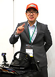 """November 21, 2017, Tokyo, Japan - Japanese robot creator Wataru Yoshizaki of Asratec displays the transformable robot """"J-deite Quarter"""" which can change its shape of a robot to a vehicle at the """"Softbank Robot World 2017"""" in Tokyo on Tuesday, November 21, 2017. Softbank's subsidiary Asratec and Brave Robotics have plan to launch a 4m tall transformable human ride robot """"J-deite RIDE"""".     (Photo by Yoshio Tsunoda/AFLO) LWX -ytd-"""