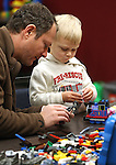 Roman Feleysher and his son Evan, 3, play at the Lego Club event at the Carson City Library, in Carson City, Nev., on Saturday, Dec. 17, 2011. .Photo by Cathleen Allison