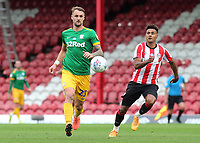 Patrick Bauer of Preston North End in possession as Brentford's Ollie Watkins looks on during Brentford vs Preston North End, Sky Bet EFL Championship Football at Griffin Park on 15th July 2020