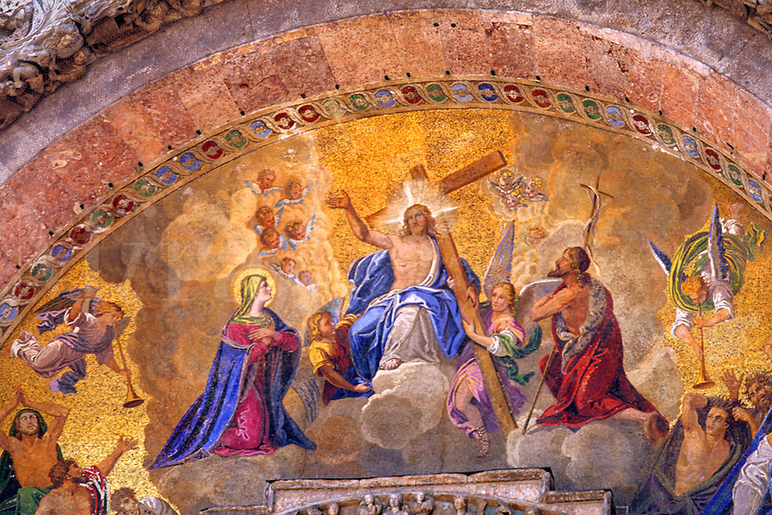 Beautiful gold artwork above San Marco Church in romantic Venice Ital