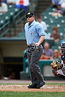 Umpire Sean Barber watches a long foul ball during a game between the Rochester Red Wings and Pawtucket Red Sox on July 1, 2015 at Frontier Field in Rochester, New York.  Rochester defeated Pawtucket 8-4.  (Mike Janes/Four Seam Images)