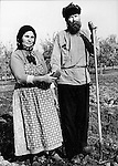 Russian Old Believers descendants of dissident Christians who split from the Russian Orthodox Church and fled to the United States work in their field on their farm, Preserve traditions dating to medieval times with peasant style clothing, Old Believer descent in Russia,