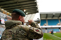 31st October 2020; The Den, Bermondsey, London, England; English Championship Football, Millwall Football Club versus Huddersfield Town; A member of the Armed Forces playing the bugle before kick off for Remembrance Sunday on the 11th November