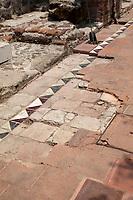 Antigua, Guatemala.  Historic Preservation: Original Colonial Floor Tiles Underneath Modern Covering.