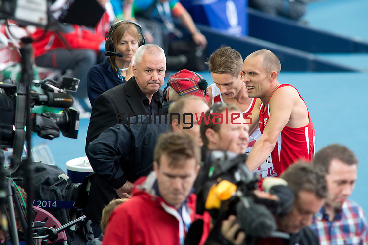 Men's 400m hurdles round 1 heat 1, Wales' Dai Greene speaks to television media at the end of the race<br /> <br /> Photographer Chris Vaughan/Sportingwales<br /> <br /> 20th Commonwealth Games - Day 7 - Wednesday 30th July 2014 - Athletics - Hampden - Glasgow - UK