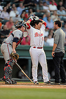 Designated hitter Michael Chavis (11) of the Greenville Drive reacts after fouling a ball off his foot in a game against the Rome Braves on Monday, June 15, 2015, at Fluor Field at the West End in Greenville, South Carolina. Chavis was a first-round pick of the Boston Red Sox in the 2014 First-Year Player Draft. (Tom Priddy/Four Seam Images)