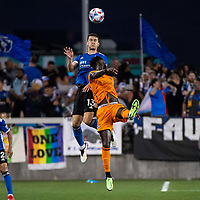 SAN JOSE, CA - JULY 24: Nathan #13 of the San Jose Earthquakes goes up for a header with Derrick Jones #21 of the Houston Dynamo during a game between San Jose Earthquakes and Houston Dynamo at PayPal Park on July 24, 2021 in San Jose, California.