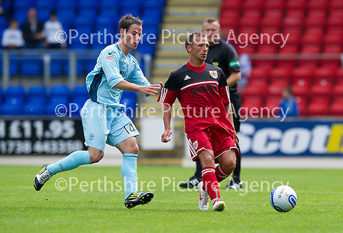 St Johnstone v Bristol City....28.07.12  Pre-Season Friendly.Ex-saint Jody Morris closed down by Kevin Moon.Picture by Graeme Hart..Copyright Perthshire Picture Agency.Tel: 01738 623350  Mobile: 07990 594431