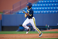 Michigan Wolverines right fielder Johnny Slater (25) running the bases during the second game of a doubleheader against the Canisius College Golden Griffins on February 20, 2016 at Tradition Field in St. Lucie, Florida.  Michigan defeated Canisius 3-0.  (Mike Janes/Four Seam Images)