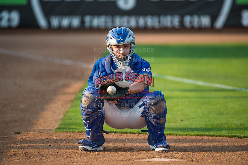 Jake Henson (27) of the Ogden Raptors warms up the starting pitcher before the game against the Helena Brewers in Pioneer League action at Lindquist Field on August 19, 2015 in Ogden, Utah. Ogden defeated Helena 4-2.  (Stephen Smith/Four Seam Images)