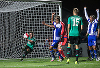 Max Machtermes of FC Schalke 04 clears the ball but its too late as Ismael Diaz de Leon (47) of Porto U21 goal is given making it 1-0 during the Premier League U21 International Cup match between Porto U21 and Schalke 04 U21 at Adams Park, High Wycombe, England on 25 September 2015. Photo by Andy Rowland.