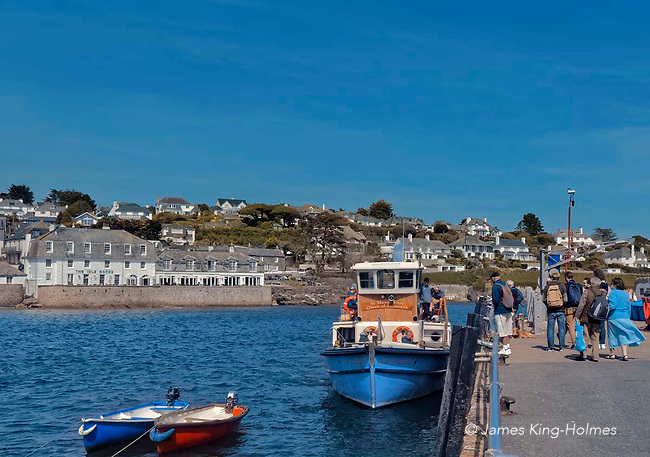 Boarding the Queen of Falmouth ferry in St Mawes harbour, Cornwall, UK  for the short journey to Falmouth across the Carrick Roads, an estuary formed by a large flooded valley created after the Ice Age by melt waters.