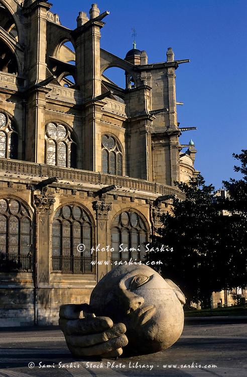 The l'Ecoute sculpture with Eglise Saint-Eustache in the background, Paris, France.