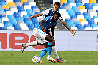 Tiemoue Bakayoko of SSC Napoli and Rafael Toloi of Atalanta BC compete for the ball during the Serie A football match between SSC Napoli and Atalanta BC at San Paolo stadium in Naples (Italy), October 17th 2020. Photo Cesare Purini / Insidefoto