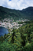 Soufriere, St. Lucia. View over palm trees down into Soufriere bay with boats and the town.