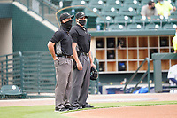 Umpires Jarred Moehlmann, left, and Paul Roemer stand before a game between the Charleston RiverDogs and Columbia Fireflies on Tuesday, May 11, 2021, at Segra Park in Columbia, South Carolina. (Tom Priddy/Four Seam Images)