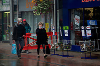 Pictured: A man and lady walk through Llanelli Town Centre, Llanelli, Wales, UK. Sunday 27 September 2020<br /> Re: Local lockdown will be in force from 6pm on the 27th of September, due to the Covid-19 Coronavirus pandemic, in Llanelli, Wales, UK