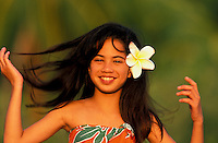 Young local Hawaiian girl smiling with flower in her hair