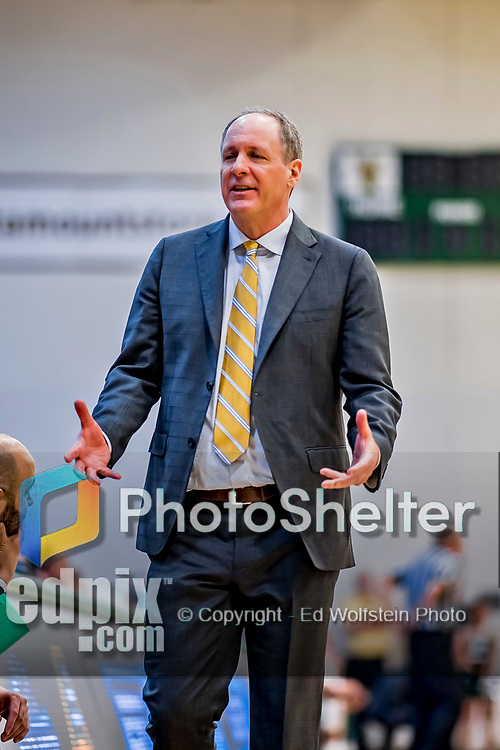 12 March 2019: University of Vermont Catamount Meghan and Robert Cioffi Men's Basketball Head Coach John Becker, works a game against the Binghamton University Bearcats at Patrick Gymnasium in Burlington, Vermont. The top-seeded Catamounts advanced to their fourth-straight America East conference championship game, defeating the Bearcats 84-51. Mandatory Credit: Ed Wolfstein Photo *** RAW (NEF) Image File Available ***