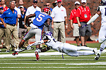 Southern Methodist Mustangs wide receiver Cedric Lancaster (5) and TCU Horned Frogs cornerback Kevin White (25) in action during the game between the TCU Horned Frogs and the SMU Mustangs at the Gerald J. Ford Stadium in Fort Worth, Texas.  TCU leads SMU 28 to 0 at half.