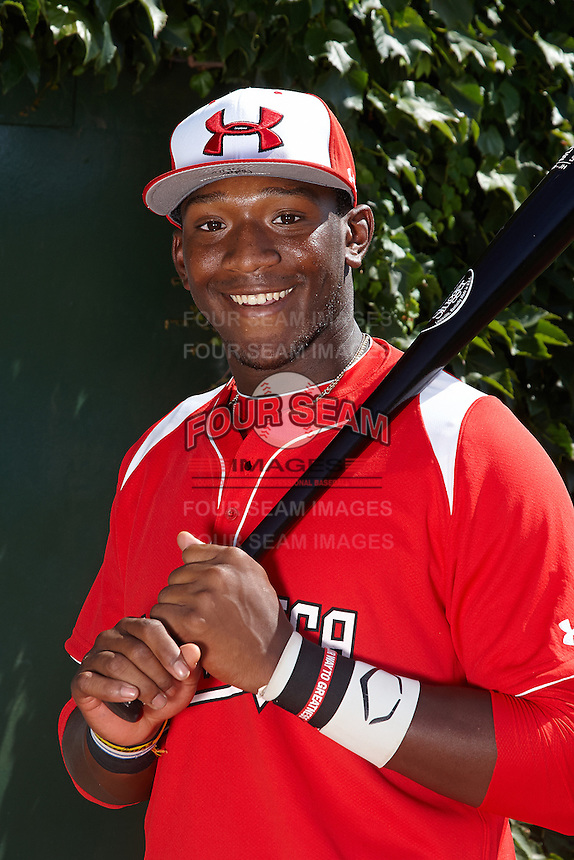 Outfielder Justin Williams #4 of Terrebonne High School in Houma, Louisiana poses for a photo before participating in the Under Armour All-American Game powered by Baseball Factory at Wrigley Field on August 18, 2012 in Chicago, Illinois.  (Mike Janes/Four Seam Images)