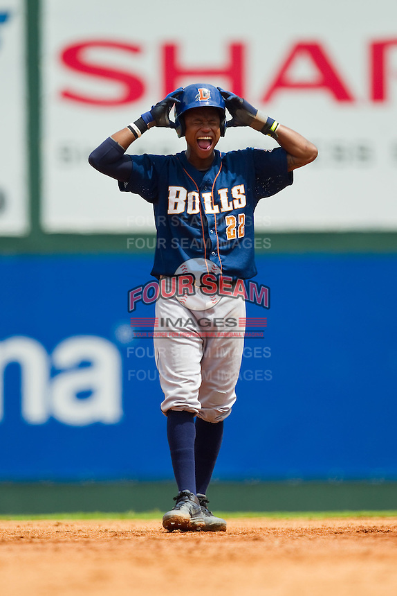 Tim Beckham (22) of the Durham Bulls adjusts his batting helmet as he takes his lead off of second base during the International League game against the Charlotte Knights at Knights Stadium on August 18, 2013 in Fort Mill, South Carolina.  The Bulls defeated the Knights 8-5 in Game One of a double-header.  (Brian Westerholt/Four Seam Images)